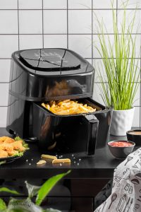 Air fryer with fries in basket