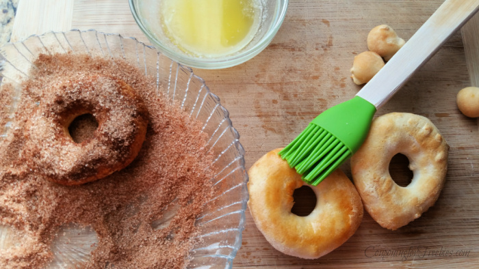 Brush donuts with butter and roll in sugar