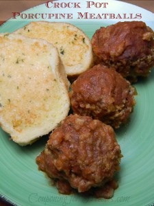 Green plate with 3 Crock Pot recipe Porcupine Meatballs and two slices of garlic toast.