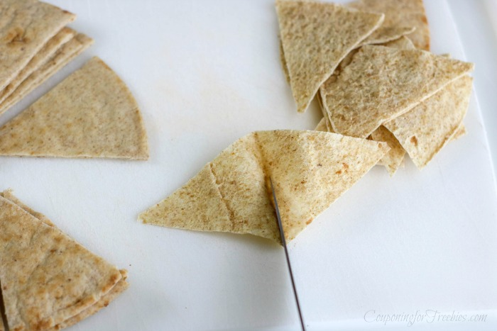 Cut pita pocket triangles in half so they are single layer