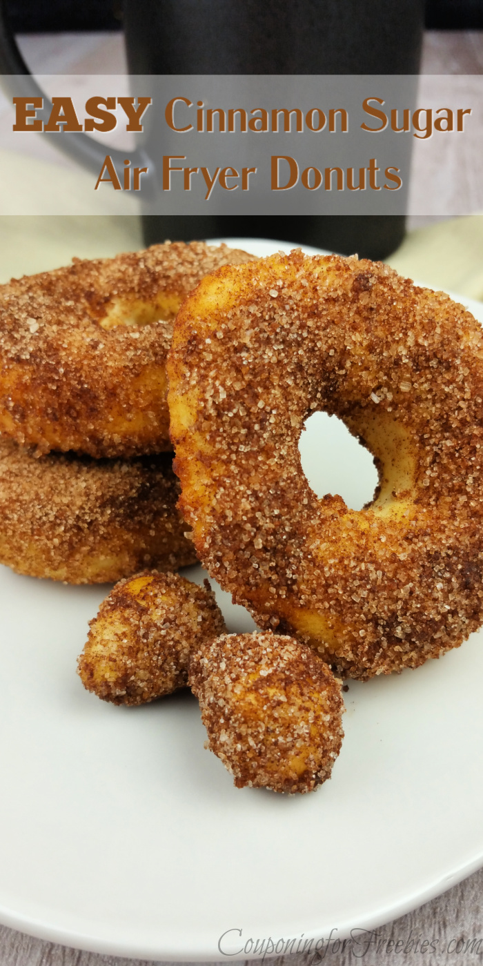 Cinnamon sugar air fryer donuts on while plate with black coffee mug in background. Text overlay at top that says Easy Cinnamon Sugar Air Fryer Donuts