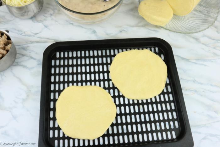 Flatten dough on air fryer tray