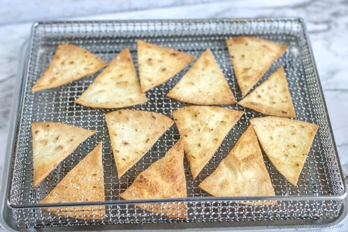 Golden baked pita chips on air fryer basket