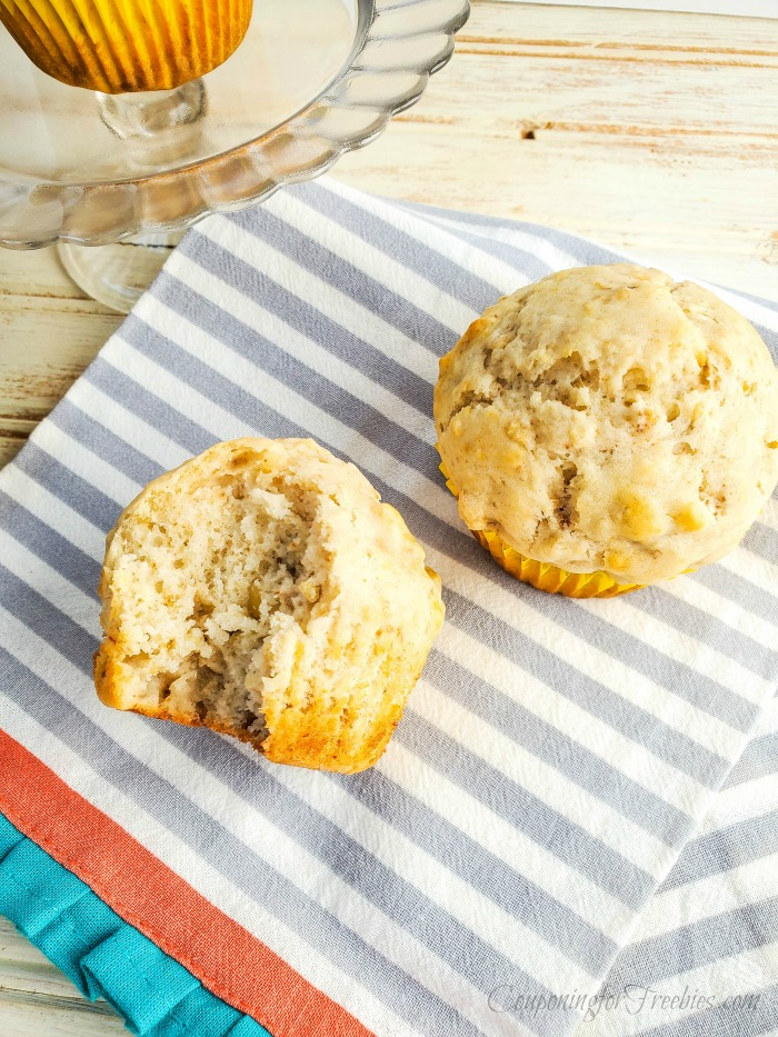 Homemade banana muffins on gray and white stripped cloth napkin