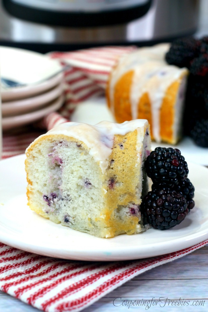 Slice of blackberry bundt cake on white plate with Instant Pot in background