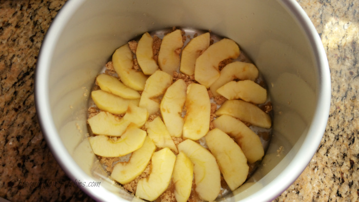 Lay sliced apples in bottom of pan