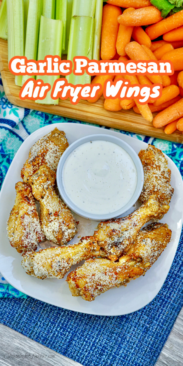 Garlic Parmesan Air Fryer Wings on white plate with fresh cut veggies in background. Text overlay at the top.