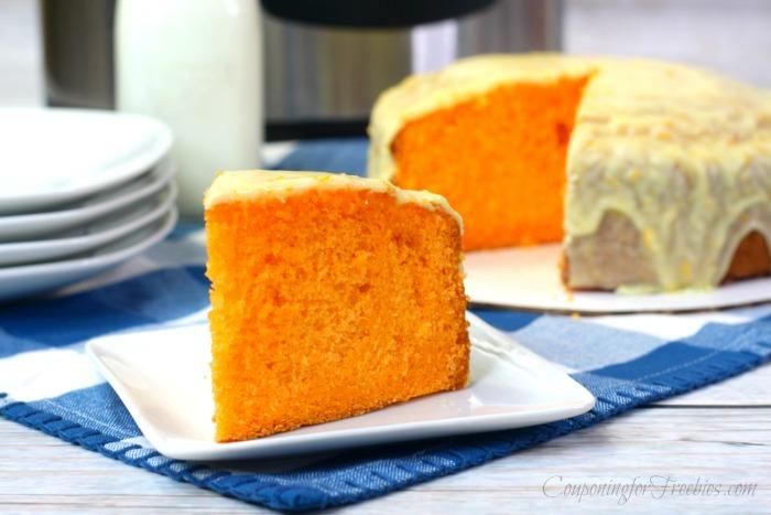 Slice of orange cake on white plate