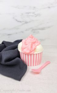 whipped strawberry sundae in pink and white paper dish