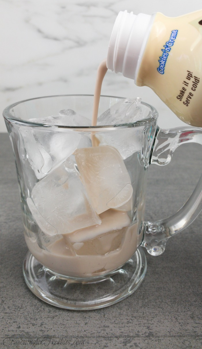 pouring milkshake into cup of ice